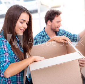 man and woman packing moving boxes