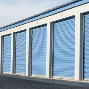 Large self storage units with blue doors.