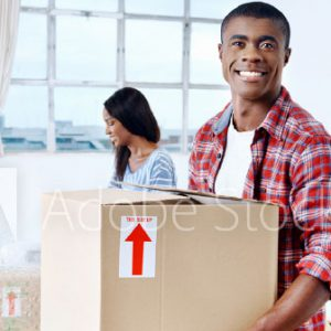 Smiling man moving storage boxes