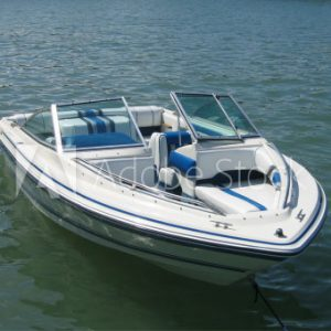 White speed boat on water