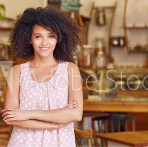 smiling woman folding arms