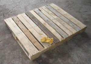 Wooden Pallet for rental unit with glove on top